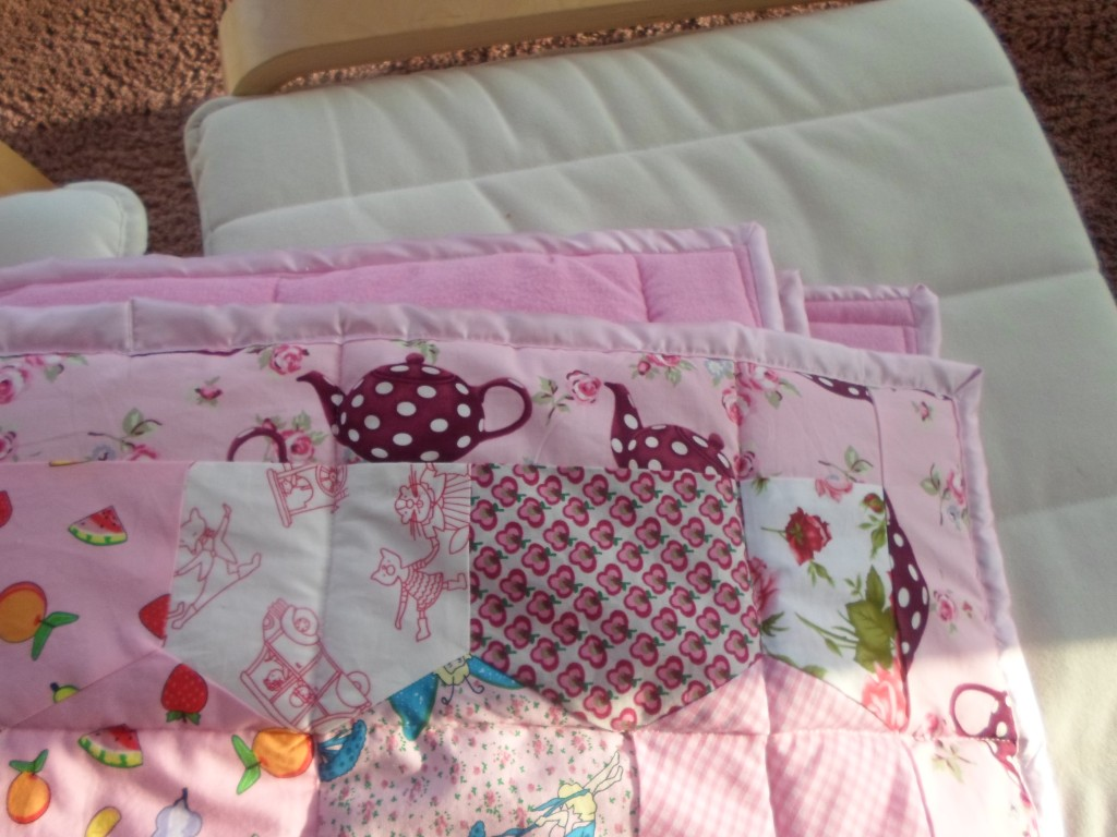 finished pink quilt, satin binding